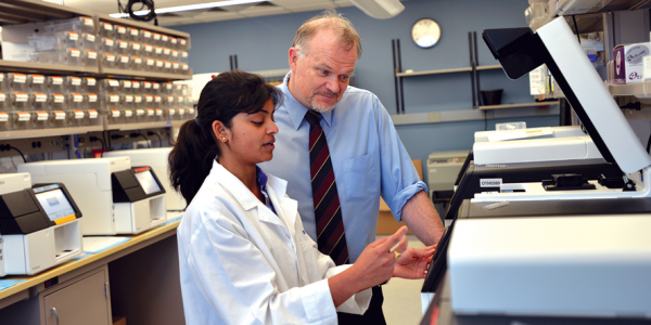 Dr. Richard Gibbs and colleague in lab